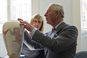 HRH Prince Charles painting a Burslem pottery vase depicting Middleport pottery.