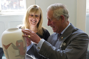 HRH Prince Charles enjoying his efforts at painting the Burslem pottery vase.